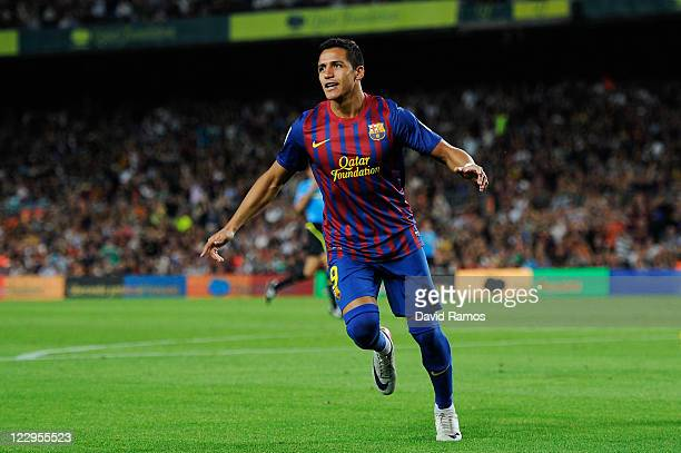 Alexis Sanchez of FC Barcelona celebrates after scoring his third team's goal during the La Liga match between FC Barcelona and Villarreal CF at Camp...