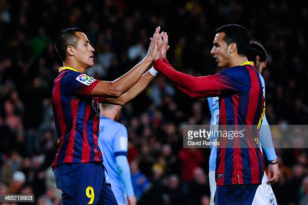 Alexis Sanchez of FC Barcelona celebrates with his team mate Pedro Rodriguez after scoring his team's third goal during the La Liga match between FC...