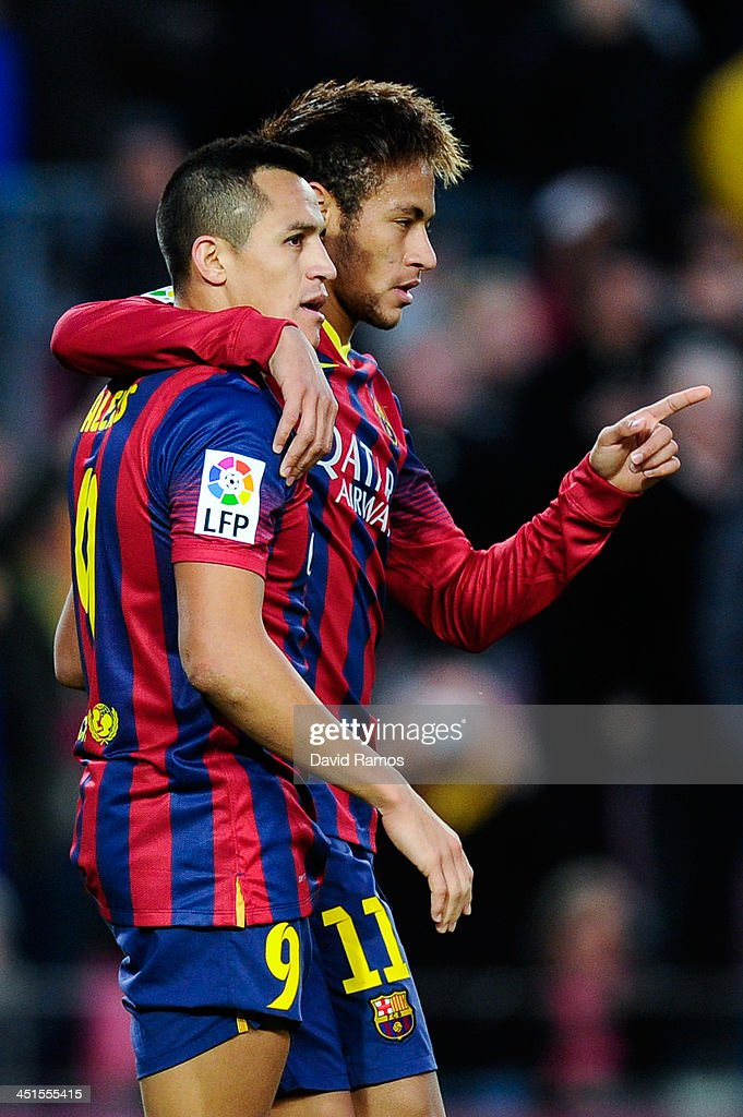 <a gi-track='captionPersonalityLinkClicked' href=/galleries/search?phrase=Alexis+Sanchez&family=editorial&specificpeople=5515162 ng-click='$event.stopPropagation()'>Alexis Sanchez</a> (L) of FC Barcelona celebrates with his teammate Neymar after scoring his team's third goal from during the La Liga match between FC Barcelona and Granda CF at Camp Nou on November 23, 2013 in Barcelona, Spain.