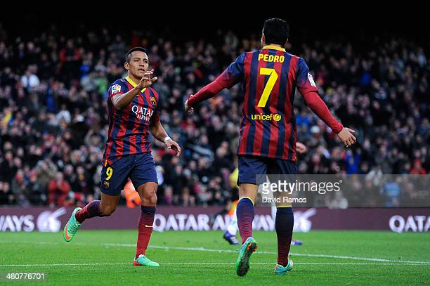 Alexis Sanchez of FC Barcelona celebrates with his teammate Pedro Rodriguez of FC Barcelona after scoring his team's third goal during the La Liga...