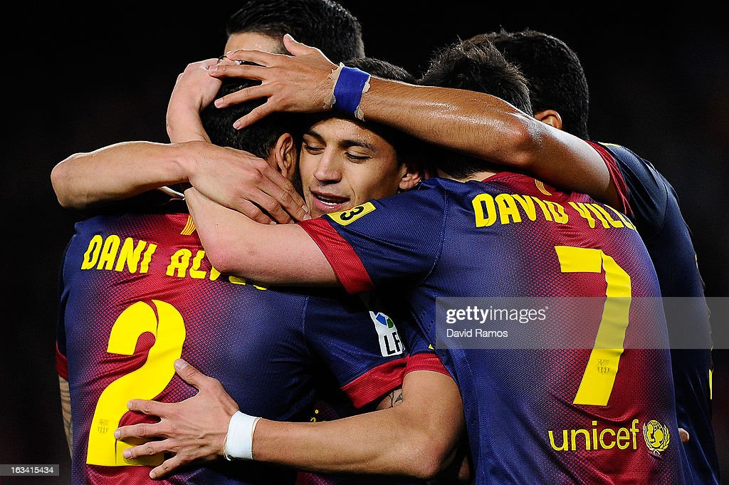 <a gi-track='captionPersonalityLinkClicked' href=/galleries/search?phrase=Alexis+Sanchez&family=editorial&specificpeople=5515162 ng-click='$event.stopPropagation()'>Alexis Sanchez</a> of FC Barcelona celebrates with his team-mates after scoring the opening goalduring the La Liga match between FC Barcelona and RC Deportivo La Coruna at Camp Nou on March 9, 2013 in Barcelona, Spain.