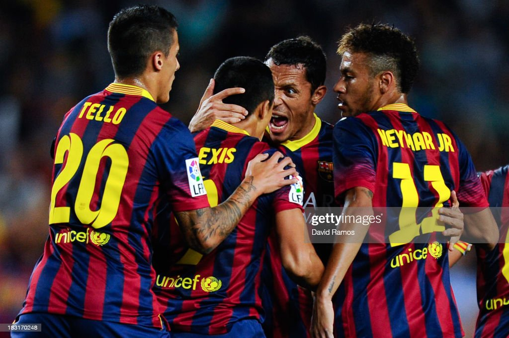 <a gi-track='captionPersonalityLinkClicked' href=/galleries/search?phrase=Alexis+Sanchez&family=editorial&specificpeople=5515162 ng-click='$event.stopPropagation()'>Alexis Sanchez</a> (2nd L) of FC Barcelona celebrates with his team-mates after scoring his team's first goal during the La Liga match between FC Barcelona and Real Valladolid CF at Camp Nou on October 5, 2013 in Barcelona, Spain.