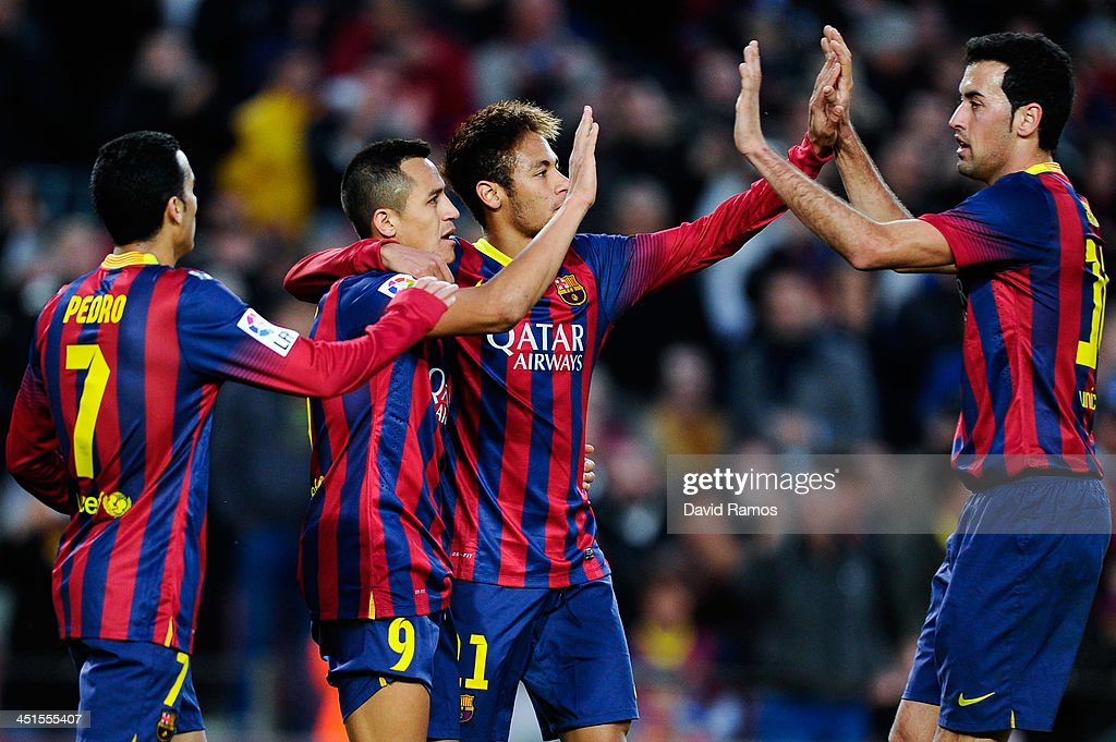 <a gi-track='captionPersonalityLinkClicked' href=/galleries/search?phrase=Alexis+Sanchez&family=editorial&specificpeople=5515162 ng-click='$event.stopPropagation()'>Alexis Sanchez</a> (2ndL) of FC Barcelona celebrates with his teammates after scoring his team's third goal from during the La Liga match between FC Barcelona and Granda CF at Camp Nou on November 23, 2013 in Barcelona, Spain.
