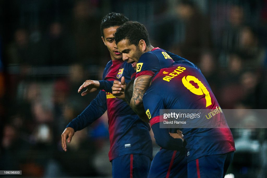 Alexis Sanchez of FC Barcelona (R) celebrates with his teammates Dani Alves (C) and Thiago Alcantara of FC Barcelona after scoring his team's fourth goal during the Copa del Rey round of sixteen second leg match between FC Barcelona and Cordoba CF at Camp Nou on January 10, 2013 in Barcelona, Spain.