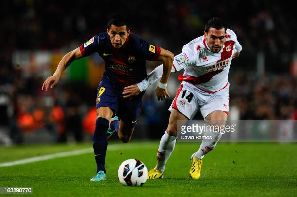 Alexis Sanchez of FC Barcelona duels for the ball with Anaitz Arbilla of Rayo Vallecano during the La Liga match between FC Barcelona and Rayo...