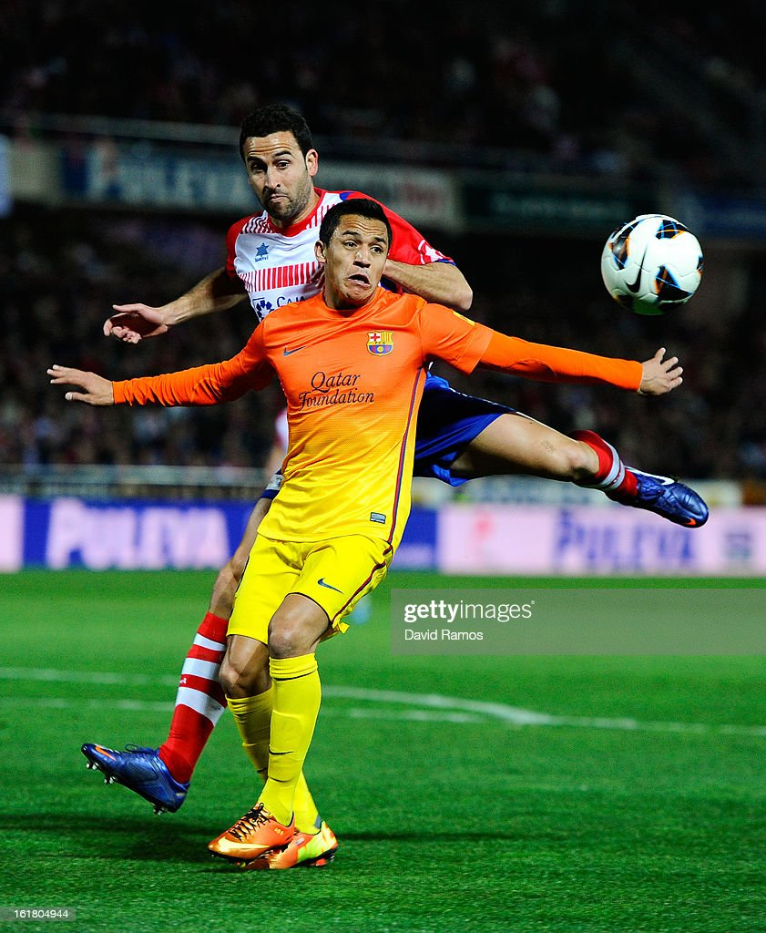 <a gi-track='captionPersonalityLinkClicked' href=/galleries/search?phrase=Alexis+Sanchez&family=editorial&specificpeople=5515162 ng-click='$event.stopPropagation()'>Alexis Sanchez</a> of FC Barcelona duels for the ball with Inigo Lopez of Granada CF during the La Liga match between Granada CF and FC Barcelona at Estadio Nuevo Los Carmenes on February 16, 2013 in Granada, Spain.