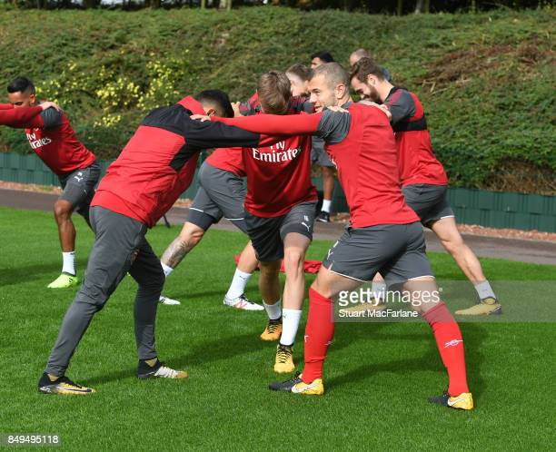 Alexis Sanchez Rob Holding and Jack Wilshere of Arsenal during a training session at London Colney on September 19 2017 in St Albans England