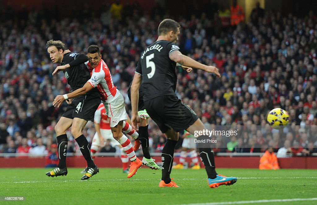 Alexis Sanchez scores Arsenal's 1st goal under pressure from Michael Duff of Burnley during the match between Arsenal and Burnley in the Barclays Premier League at Emirates Stadium on November 1, 2014 in London, England.