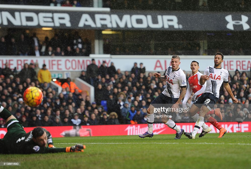 Alexis Sanchez scores Arsenal's 2nd goal under pressure from Toby Alderweireld and Mousa Dembele of Tottenham during the Barclays Premier League match between Tottenham Hotspur and Arsenal at White Hart Lane on March 5, 2016 in London, England.