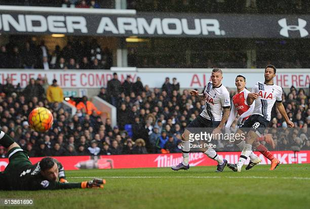 Alexis Sanchez scores Arsenal's 2nd goal under pressure from Toby Alderweireld and Mousa Dembele of Tottenham during the Barclays Premier League...