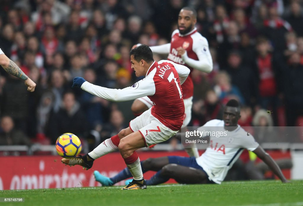 Alexis Sanchez scores Arsenal's second goal during the Premier League match between Arsenal and Tottenham Hotspur at Emirates Stadium on November 18, 2017 in London, England.