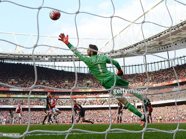 Alexis Sanchez scores his 2nd goal Arsenal's 3rd past David De Gea of manchester United during the Barclays Premier League match between Arsenal and...