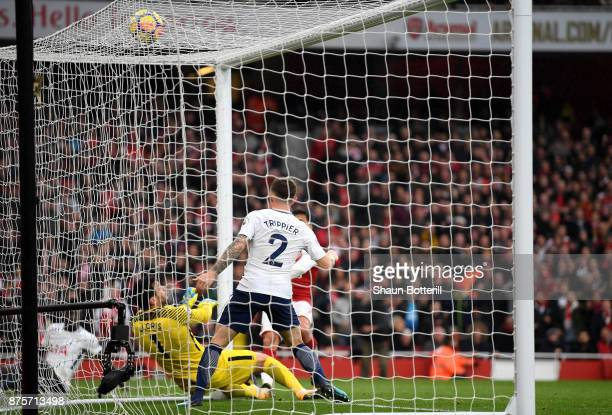 Alexis Sanchez scores the second goal for Arsenal during the Premier League match between Arsenal and Tottenham Hotspur at Emirates Stadium on...