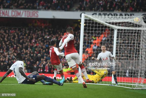 Alexis Sanchez shoots past Tottenham goalkeeper Hugo Lloris to score the 2nd Arseal goal of Arsenal during the Premier League match between Arsenal...