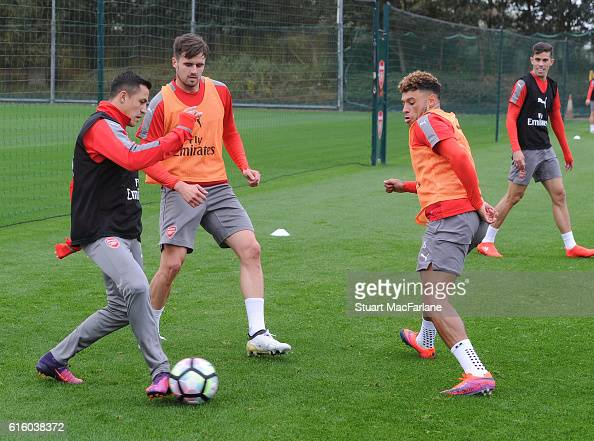 Alexis Sanxhez Carl Jenkinson and Alex OxladeChamberlain of Arsenal during a training session at London Colney on October 21 2016 in St Albans England
