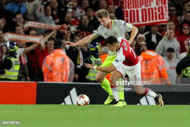 Alexis S·nchez of Arsenal and Lukas Kluenter of FC Koeln battle for the ball during the UEFA Europa League group H match between Arsenal FC and 1 FC...
