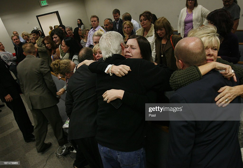 Alexis Sommers MacNeill, (C), and other family members embrace after the court adjourned following the guilty verdicts against her father Martin MacNeill, he was found guilty by the jury for the murder of his wife Michele MacNeill on November 9, 2013 in Provo, Utah. Martin MacNeill, was found guilty of murdering his wife Michele MacNeill in 2007 to continue an affair with a younger woman.