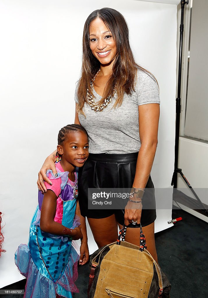 Alexis Stoudemire (L) attends Disney's The Little Mermaid special screening at Walter Reade Theater on September 21, 2013 in New York City.