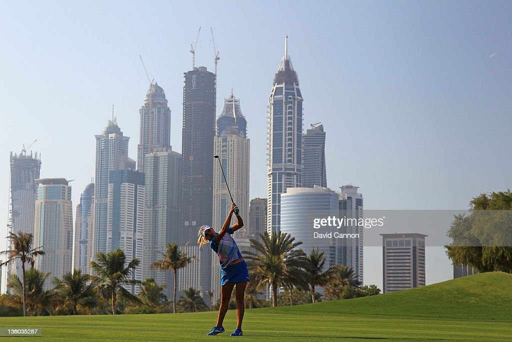 Alexis Thompson of the USA plays her second shot on the par 5 13th hole during the fourth round of the 2011 Omega Dubai Ladies Masters on the Majilis...