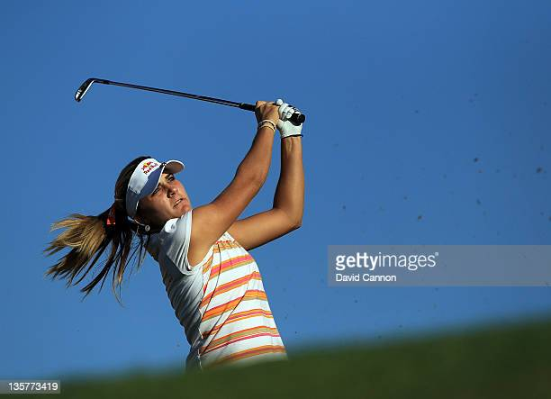 Alexis Thompson of the USA plays her tee shot at the par 3 4th hole during the first round of the 2011 Omega Dubai Ladies Masters on the Majilis...