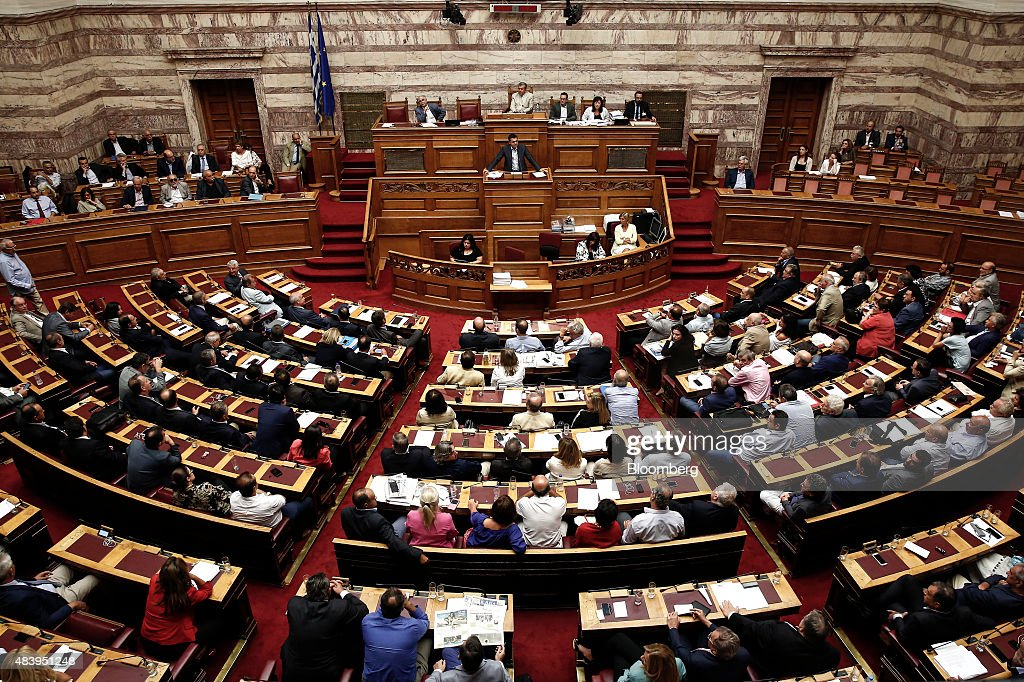 Alexis Tsipras Greece's prime minister center speaks to lawmakers during a vote on a bailout deal in Athens Greece on Friday Aug 14 2015 Greece's...
