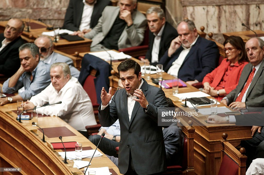 Alexis Tsipras Greece's prime minister center speaks with lawmakers before a parliamentary vote on whether to accept bailout conditions in Athens...
