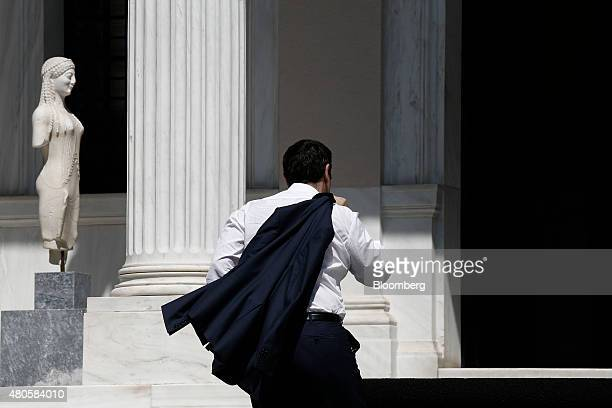 Alexis Tsipras Greece's prime minister enters Maximos Mansion after returning from Brussels following a debt deal in Athens Greece on Monday July 13...