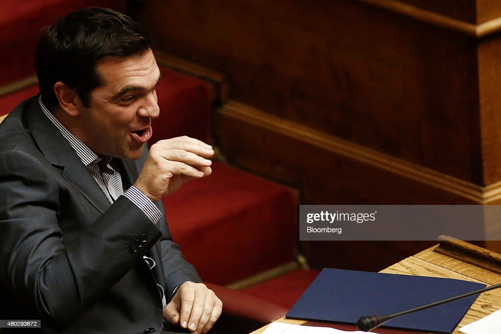 Alexis Tsipras, Greece's prime minister, gestures and speaks as he presents his package of bailout measures, inside the Greek parliament in Athens, Greece, on Saturday, July 11, 2015. Greek lawmakers debated Prime Minister Alexis Tsiprasâs bailout proposal into the early hours of Saturday before a weekend of political wrangling with creditors on his nationâs place in the euro. Photographer: Kostas Tsironis/Bloomberg via Getty Images