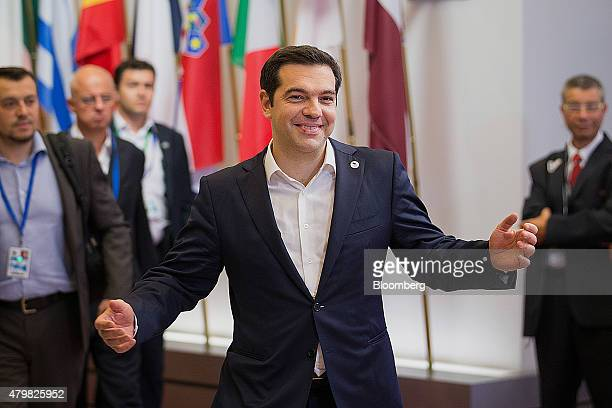 Alexis Tsipras Greece's prime minister gestures while departing after an emergency Greek summit with European leaders in Brussels Belgium on Tuesday...