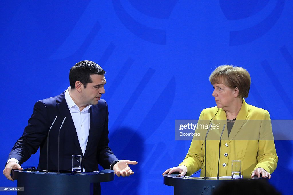 Alexis Tsipras Greece's prime minister left speaks as Angela Merkel Germany's chancellor looks on during a news conference at the Chancellery in...