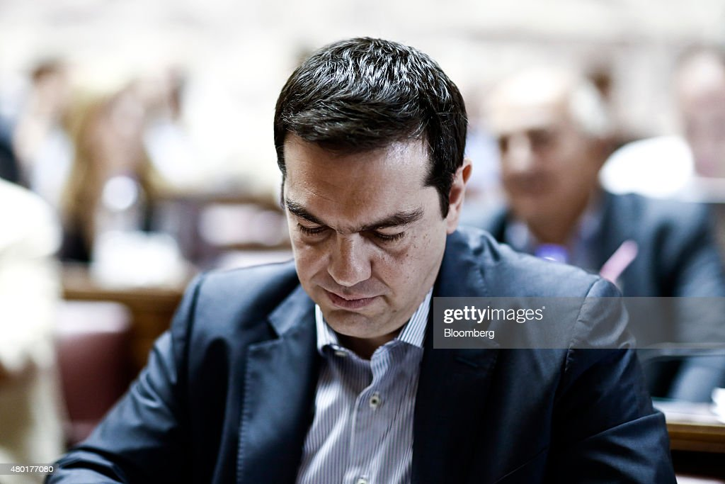 Alexis Tsipras, Greece's prime minister, reads documents after arriving at the Greek parliament to address lawmakers in Athens, Greece, on Friday, July 10, 2015. In an 11th-hour bid to stay in the euro, the government of Tsipras offered to meet most of the demands made by creditors in exchange for a bailout of 53.5 billion euros ($59.4 billion). Photographer: Kostas Tsironis/Bloomberg via Getty Images