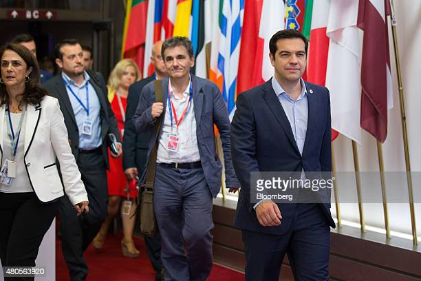 Alexis Tsipras Greece's prime minister right and Euclid Tsakalotos Greece's finance minister center depart following allnight bailout talks in...