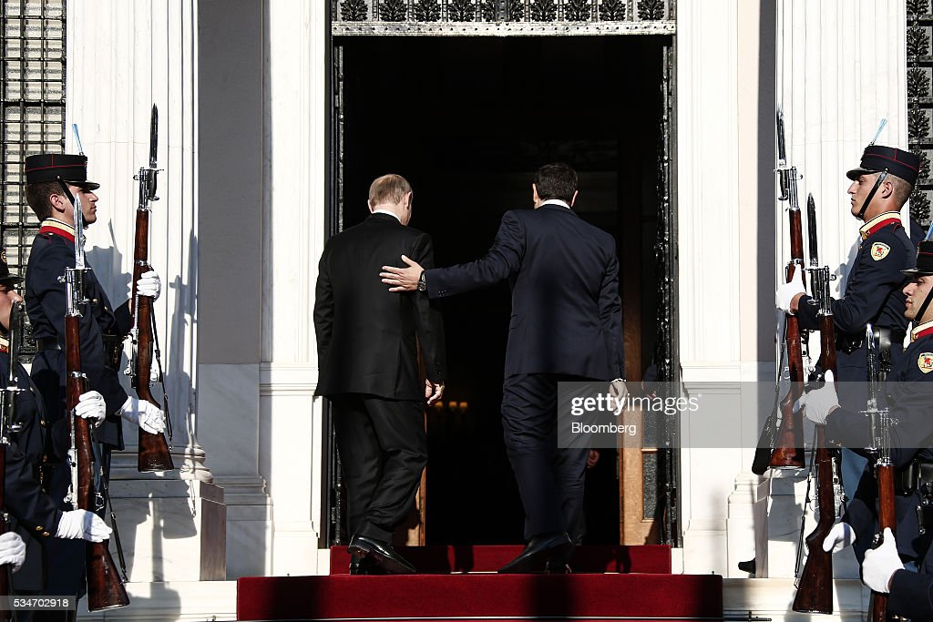 Alexis Tsipras, Greece's prime minister, right, escorts Vladimir Putin, Russia's president, at Maximos Mansion in Athens, Greece, on Friday, May 27, 2016. The Russian president is visiting Athens at a time when Greece is turning a page, economic recovery is in prospect, Tsipras said in comments at start of meeting. Photographer: Yorgos Karahalis/Bloomberg via Getty Images