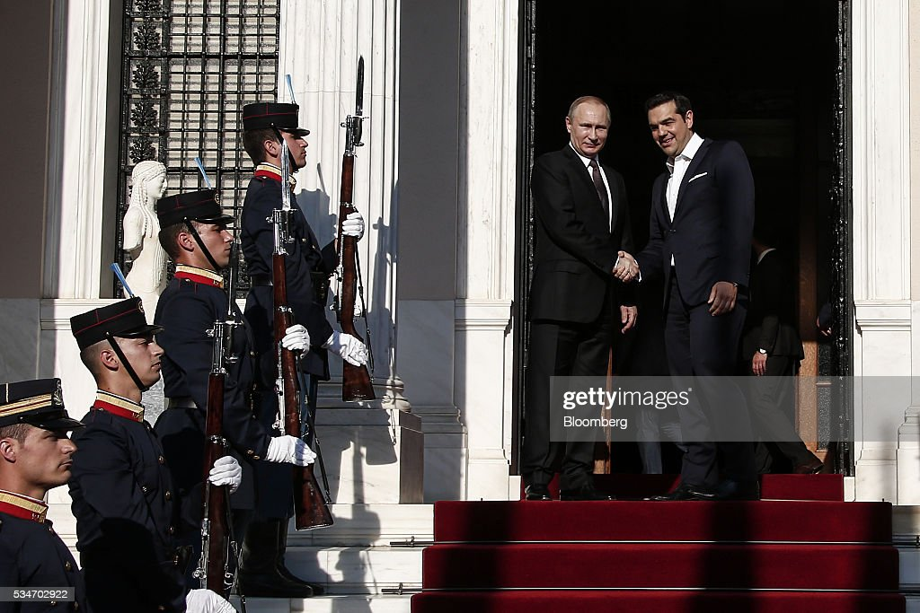 Alexis Tsipras, Greece's prime minister, right, shakes hands with Vladimir Putin, Russia's president, at Maximos Mansion in Athens, Greece, on Friday, May 27, 2016. The Russian president is visiting Athens at a time when Greece is turning a page, economic recovery is in prospect, Tsipras said in comments at start of meeting. Photographer: Yorgos Karahalis/Bloomberg via Getty Images