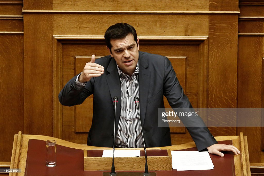 Alexis Tsipras, Greece's prime minister, speaks as he presents his package of bailout measures, inside the Greek parliament in Athens, Greece, on Saturday, July 11, 2015. Greek lawmakers debated Prime Minister Alexis Tsiprasâs bailout proposal into the early hours of Saturday before a weekend of political wrangling with creditors on his nationâs place in the euro. Photographer: Kostas Tsironis/Bloomberg via Getty Images