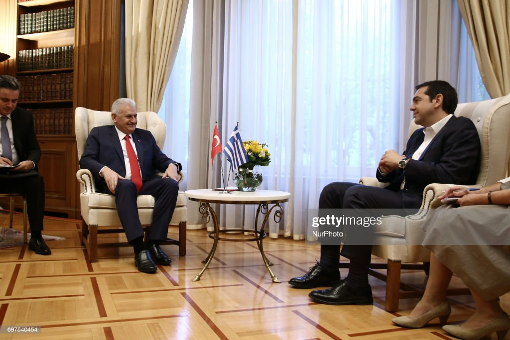 PM Alexis Tsipras meets (R) meets Prime Minister of Turkey Binali Yildirim, at Maximos mansion in Athens on June 19, 2017. Yildirim will also visit the northeastern region of Thrace which has a Muslim minority, where he will partake in iftar, the meal when Muslims end the Ramadan fast at sunset.