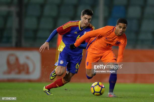 Alexis Villagrasa of Andorra U21 Justin Kluivert of Holland U21 during the match between Holland U21 v Andorra U21 at the De Vijverberg on November...