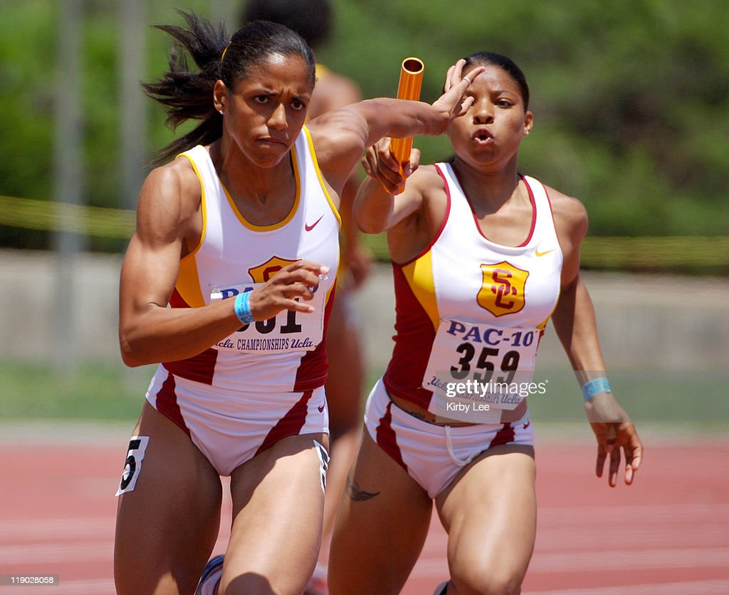 Alexis Weatherspoon of USC takes handoff from Tracee Thomas on the anchor of the women's 400meter relay in the Pacific10 Conference Track Field...