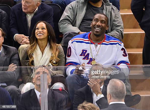 Alexis Welch and Amare Stoudemire attend the Philadelphia Flyers vs New York Rangers playoff game at Madison Square Garden on April 30 2014 in New...
