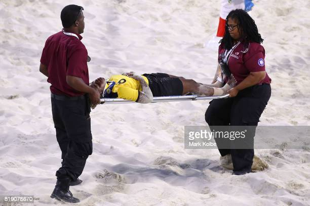 Alexis Woodside of the Bahamas is stretchered of the field during the Girls Beach Soccer match 3 between the Bahamas and Jamaica on day 2 of the 2017...