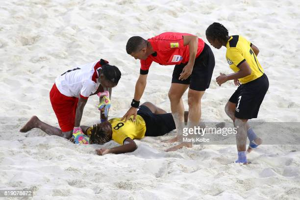 Alexis Woodside of the Bahamas lies injured on the ground during the Girls Beach Soccer match 3 between the Bahamas and Jamaica on day 2 of the 2017...
