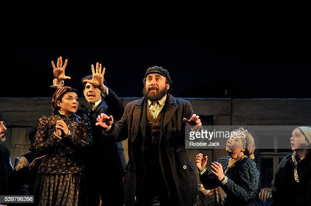 Alexis Zegerman as Rivka Damien Molony as Moti Antony Sher as Jacob Bindel and Abigail McKern as Ida with artists of the company in Nicholas Wright's...