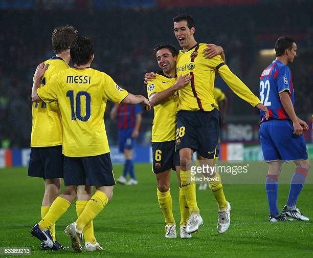 Alexsandr Hleb Lional Messi and Sergi Busquets celebrate with goalscorer Xavi Hernandez during the UEFA Champions League Group C match between Basel...