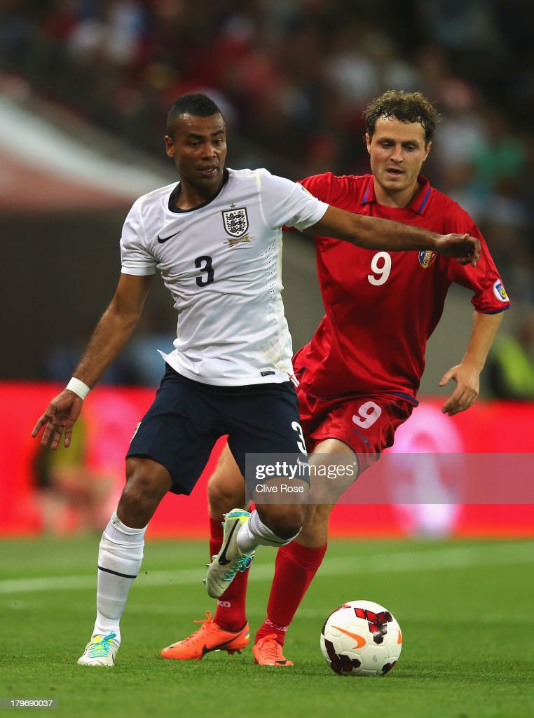 Alexsandru Antoniuc of Moldova (R) challenges Ashley Cole of England during the FIFA 2014 World Cup Qualifying Group H match between England and Moldova at Wembley Stadium on September 6, 2013 in London, England.