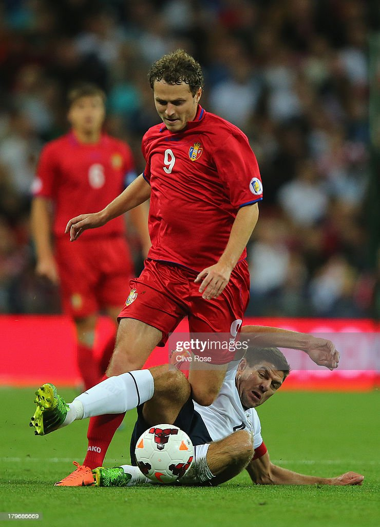 Alexsandru Antoniuc of Moldova is tackled by <a gi-track='captionPersonalityLinkClicked' href=/galleries/search?phrase=Steven+Gerrard&family=editorial&specificpeople=202052 ng-click='$event.stopPropagation()'>Steven Gerrard</a> of England during the FIFA 2014 World Cup Qualifying Group H match between England and Moldova at Wembley Stadium on September 6, 2013 in London, England.