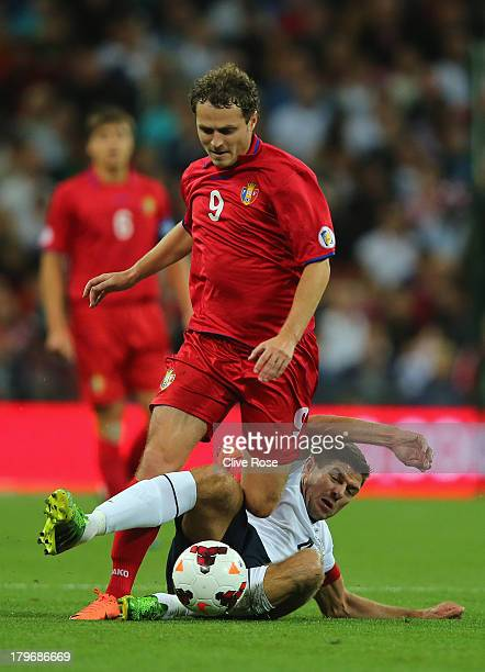 Alexsandru Antoniuc of Moldova is tackled by Steven Gerrard of England during the FIFA 2014 World Cup Qualifying Group H match between England and...