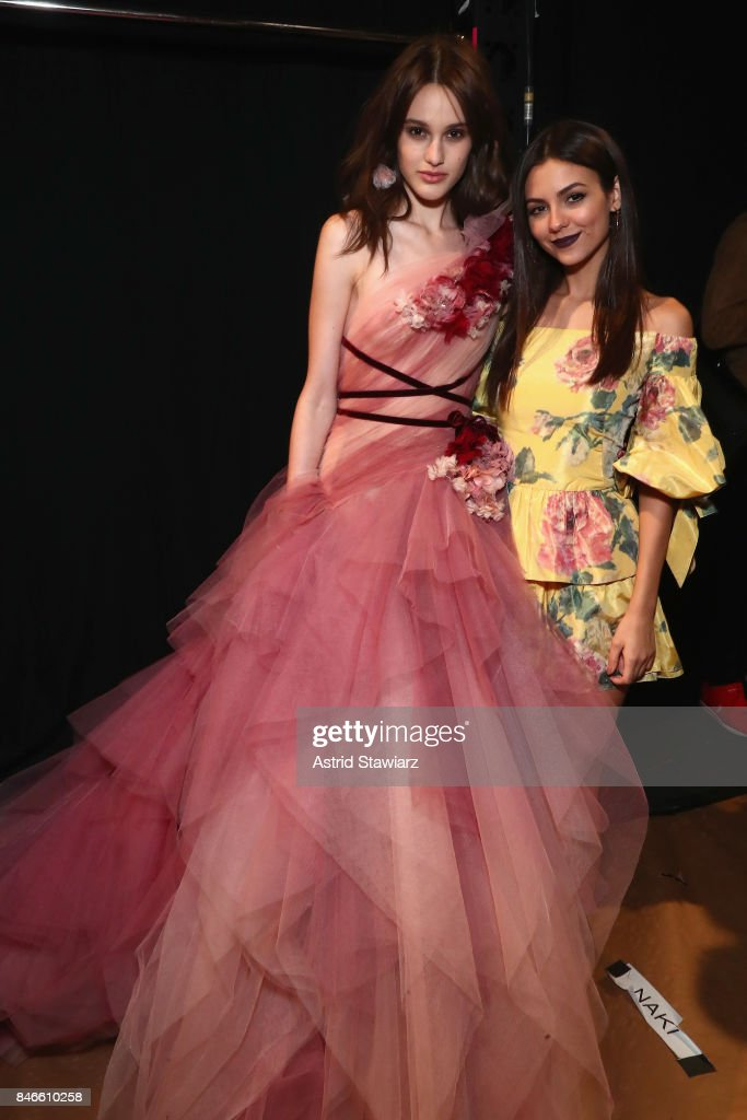 Aleyna FitzGerald and Victoria Justice pose backstage for the Marchesa fashion show during New York Fashion Week: The Shows at Gallery 1, Skylight Clarkson Sq on September 13, 2017 in New York City.