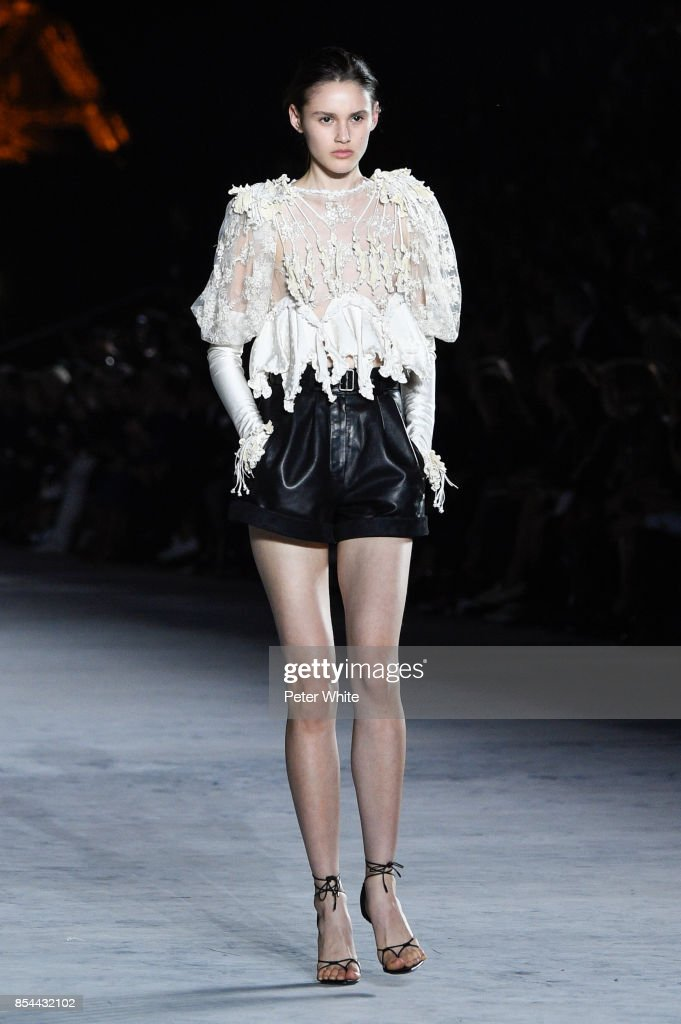 Aleyna Fitzgerald walks the runway during the Saint Laurent show as part of the Paris Fashion Week Womenswear Spring/Summer 2018 on September 26, 2017 in Paris, France.