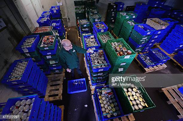 Alf Collington volunteer packs food at a food bank on March 7 2014 in Falkirk Scotland Charities based in Scotland are reporting that many families...