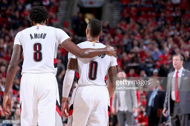 AlFarouq Aminu and Damian Lillard of the Portland Trail Blazers talk during the game against the Golden State Warriors during Game Four of the...
